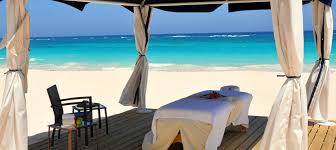 covered massage table located on the beach